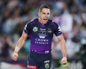 Billy Slater celebrates scoring for the Storm against the Cowboys in the NRL Grand Final in...