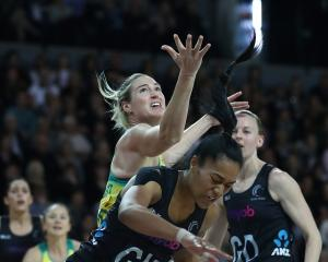 Temalisi Fakahokotau of New Zealand and Caitlin Bassett of Australia contest the ball during the...