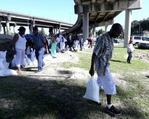 New Orleans residents fill sand bags in preparation for Tropical Storm Nate on in New Orleans,...