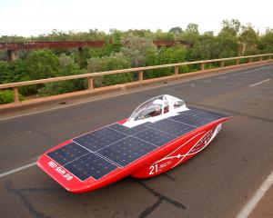 Solar Team Twente vehicle 'RED Shift' of The Netherlands crosses the Katherine river as it races...