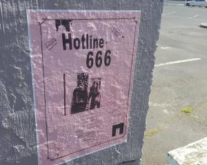 Poster for Hotline 666 gig on Vogel St. Photo: James Hall
