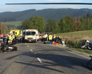 A vehicle lies torn in two as the result of a two-car collision on the Geraldine-Fairlie Highway...