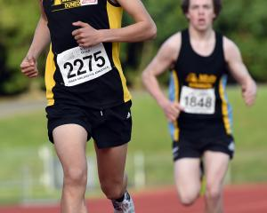 Josh Hou (14), of John McGlashan College, wins the Ness Cup handicap mile from Drew Cairney (16),...