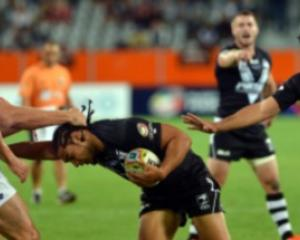 Kiwi Martin Taupau is held in a tackle.