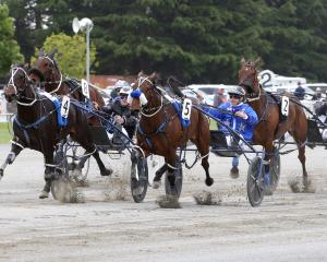 Lazaruz and Mark Purdon (outer) get up to beat stablemate Dream About Me and Tim Williams in the...