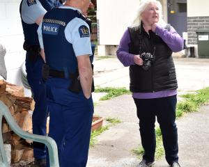 Rachael Brinsdon yesterday discusses her concerns with police about a macrocarpa partly on her...