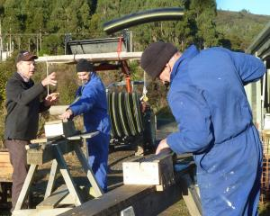 Volunteers at work constructing new bait stations. Photo: Alyth Grant