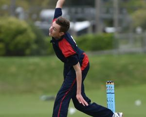 John McGlashan College bowler Ben Hatton (15) sends down a delivery during the final of the...