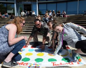 "Playing Twister during a staff ""lockout'' at Otago Polytechnic are (from left) Debz Cracknell,..."