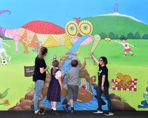 Sacred Heart School teacher aide and artist Ruan Barton (right) explains the inspiration behind...