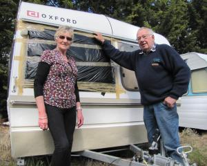 Winton couple Mary and Keith Cooper stand in front of their damaged caravan in Alexandra...