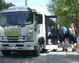 Wakatipu High School pupils board a school bus on Gorge Rd yesterday. Photo: Guy Williams