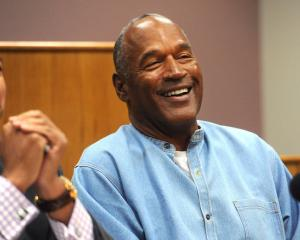 O.J. Simpson reacts during his parole hearing at Lovelock Correctional Center in Lovelock, Nevada...