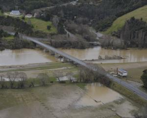 A wet start to spring undermined efforts in many rural communities. Pictured: A flooded Taieri...