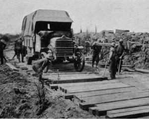 New Zealand pioneers lay a new road, immediately after the advance at Messines. - Otago Witness,...