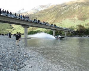 Spectators watch as Gareth Munro (Christchurch) speeds under a bridge over the Dart River near Glenorchy in his A class boat on Saturday. Photos: Paul Taylor.