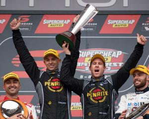 Luke Youlden and David Reynolds on the podium after winning at Bathurst yesterday. Photo: Getty...