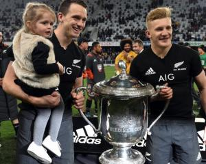 Who's better? Ben Smith and his daughter Annabelle with the Bledisloe Cup and All Black Damian...