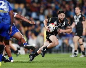 Shaun Johnson makes a run during 2017 Rugby League World Cup match between the New Zealand Kiwis...