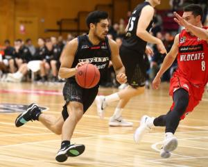 Breakers point guard Shea Ili dribbles at Perth Wildcats guard Jarrod Kenny at the NBL preseason...