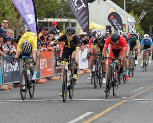 Michael Torckler wins the stage yesterday on the Tour of Southland with yellow jersey holder...