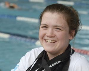 Neptune swimmer Erika Fairweather (13) yesterday with 29 national medals she has won this year at...
