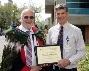 Dunedin School of Medicine dean Prof Barry Taylor (left) congratulates orthopaedic surgeon John...
