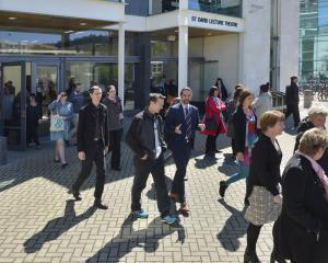 University of Otago staff leave the St David lecture theatre following the announcement of 160...