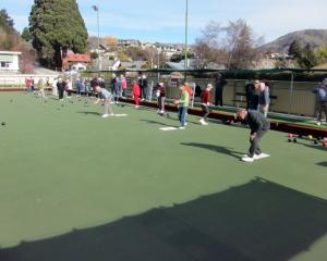 Club members take to the green for the start of the summer season last month. The club will...