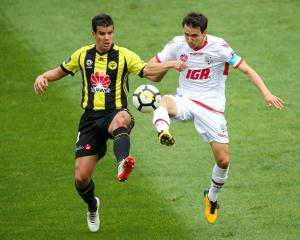 Isaias of Adelaide United and Andrija Kaludjerovic of the Phoenix compete for the ball during...