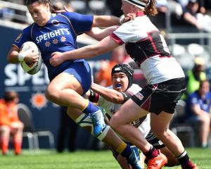 Otago spirit replacement back Kilistina Moata'ane tries to bust through the tackles of North...