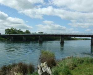 Police said the man went ''down and under'' the bridge over the Clutha River at Allangrange Rd.
