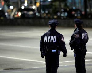 Police look towards the scene after the attack took place on West Side Highway in Manhattan....