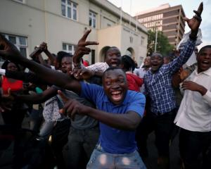 People celebrate in Harare after President Robert Mugabe resigned. Photo Reuters