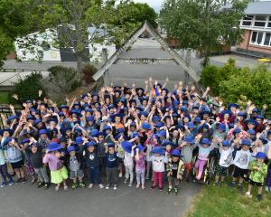 Sawyers Bay School pupils show how large their school has grown during the past five years. Photo...
