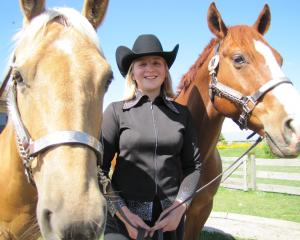 Ranfurly teen Amanda Voice relaxes with her horses Slider (left) and Wade. The 15-year-old has...