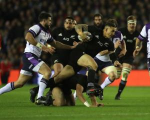 Sonny Bill Williams is tackled for the All Blacks in their match against Scotland at the weekend....