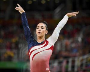 Alexandra Raisman of USA competes on the beam during the women's team final in Artistic...
