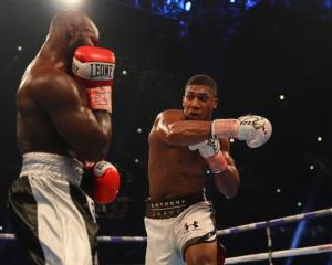 Anthony Joshua throws a right-hand punch in his recent fight against Carlos Takam. Photo: Getty...
