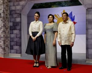 Jacinda Ardern poses with Philippines President Rodrigo Duterte and Honeylet Avancena as she...