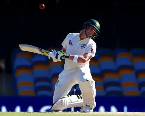 Australia's captain Steve Smith avoids a bouncer bowled by England's Stuart Broad during the...