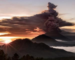 Mount Agung volcano is seen spewing smoke and ash in Bali. Photo: Emilion Kuzma-Floyd @eyes_of_a...