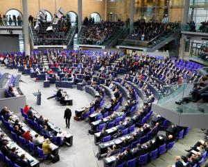 Members of the Bundestag, German lower house of Parliament, are seen during a session of the...