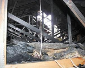 The fire was burning for at least 10 minutes in the ceiling space before it set off a smoke...