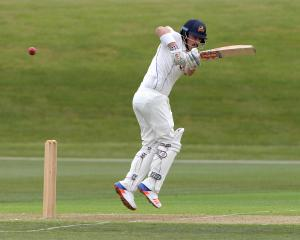 Otago opener Hamish Rutherford plays a shot off his legs on his way to a century in his side's...