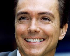 David Cassidy smiles for photographers outside the Phoenix theatre in London in 1995. Photo: Reuters