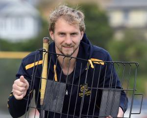 Taieri hockey club stalwart Dean Williamson (31) at the McMillan hockey turf yesterday after...