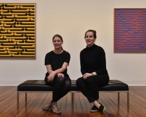 Two of the three co-curators of the Gordon Walters retrospective, Lucy Hammonds (left, Dunedin...