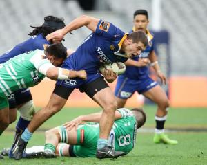 Dillon Hunt on the charge for Otago against Manawatu in Dunedin in September. Photo Getty