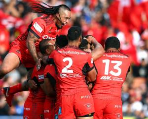 Tonga celebrate during the 2017 Rugby League World Cup match between the New Zealand Kiwis and...